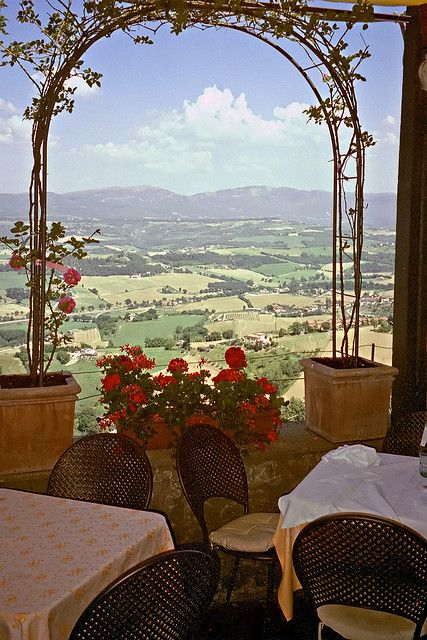 Enjoy outdoor dining with a beautiful view on a pilgrimage to Assisi. (Todi, Umbria region, Province of Perugia)
