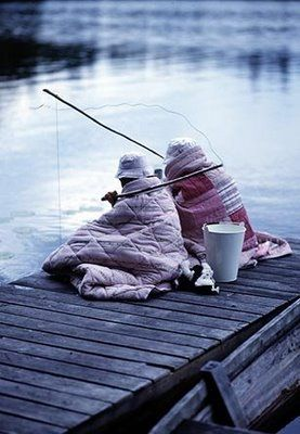 This picture makes me laugh....what a life....quilts and fishing!  This reminds me of my Grandmother who did this sort of thing with her best friend & fellow fishe-person, all the time.  We lived on a lake & they would even wade out in the lake with each thing they needed including sandwiches in plastic bags around their necks and hooks in their wide brim straw hats)!  What a joyful memory! s