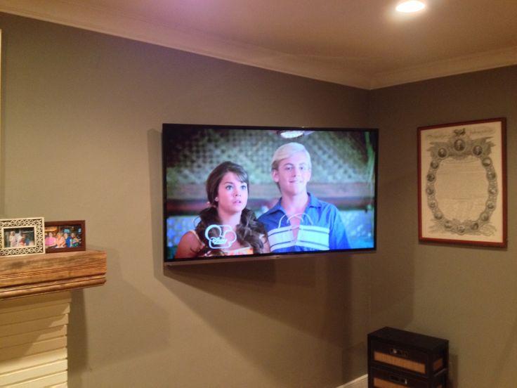 Full motion TV wall mount installation beside fireplace