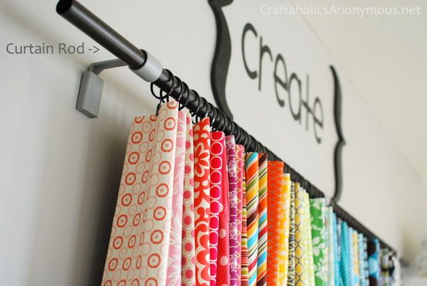 Hang Fabric on Curtain Rod! Maybe add Floating Shelf Above to Help w/Dust and Store Bins for Notions??