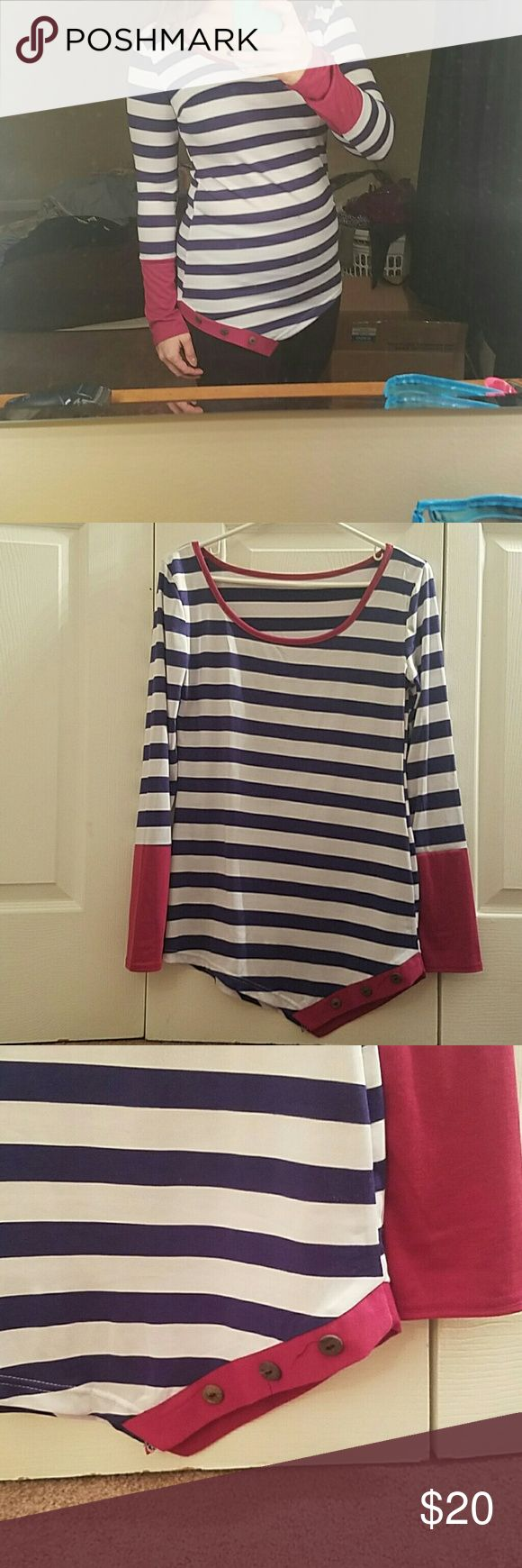 Retail stripped long sleeve shirt with buttons Bought for myself from a retail site but never ended up wearing it. Brand new but no tags or retail pavkaging. Navy and white stripes with magenta sleeves and collar. A symmetrical cut with three buttons. Tag says XL but runs small! I am typically a small/medium. It is stretchy though Tops Tees - Long Sleeve