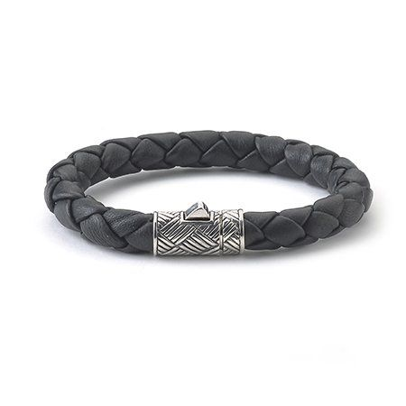 Bracelet in black braided leather with a sterling silver push clasp, $155; The Samuel B. Collection