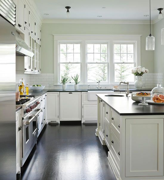1000 Ideas About Hamptons Kitchen On Pinterest: Reflective Surfaces And Large Windows Keep The Spacious Black-and-white Kitchen Well-lit During