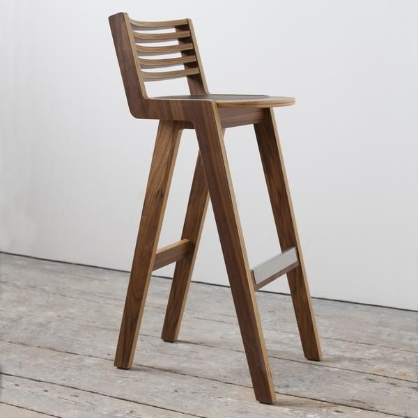 Beautifully made from walnut veneered birch ply, Extremely solid construction featuringstainless steel foot rest, Forbo linoleum seat pad and slatted back rest