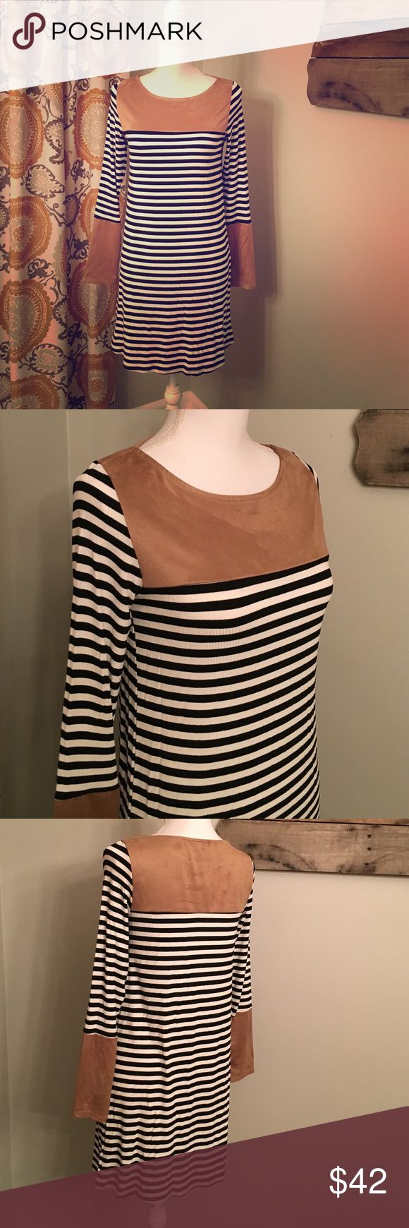 🆕💥SALE💥Stripe Dress With Faux Suede Detail The perfect weekend dress! Throw on with boots and a puffer vest and you're out the door! Super comfy. Black and white stripe with tan faux suede at top and on sleeves. Available  in L, XL. Dresses
