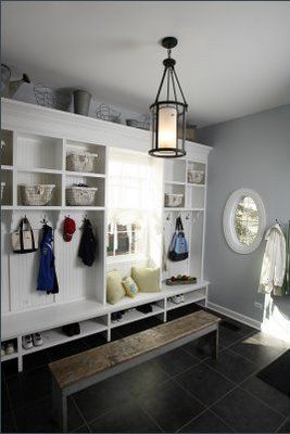 I love the bright white storage against the wall color. The light fixture is fabulous too.