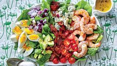 Shrimp Cobb Salad with Bacon Dressing | These favorite springtime dishes give plenty of reasons to celebrate. Our March issue might be about making your home look good on the outside, but we have plenty of ways to make it just as inviting on the inside with our best springtime recipes yet. Fill your kitchen with the makings of a bright and beautiful Easter brunch, complete with an easy-to-prepare spread of top-your-own ham biscuits with our favorite sweet and savory toppers, fresh springtime