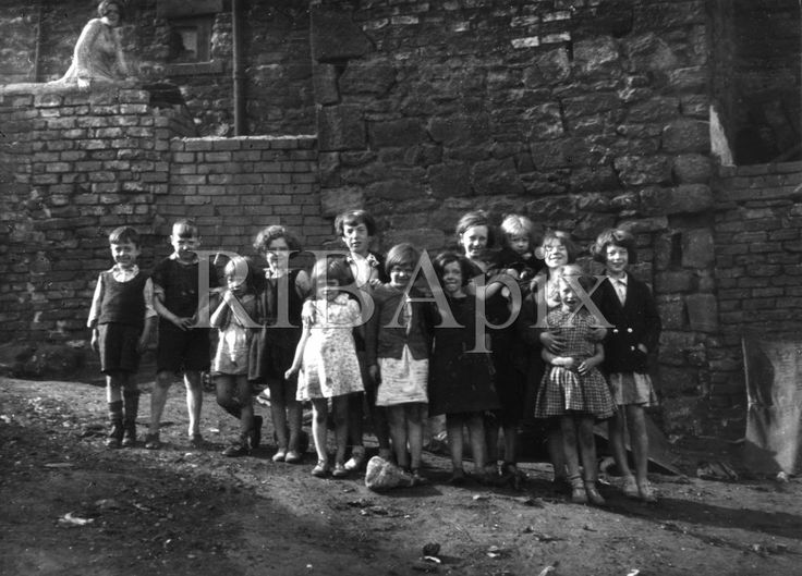Miners' children in Ashington, Northumberland (1936) by the architectural photographer Edwin Smith (1912-1971). KR. [RIBA54186]