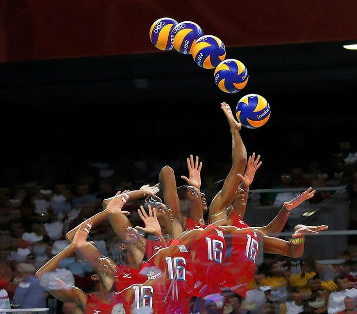 A multiple exposure images shows the form of Foluke Akinradewo of the U.S. serving against Turkey during the women's group B volleyball matc...