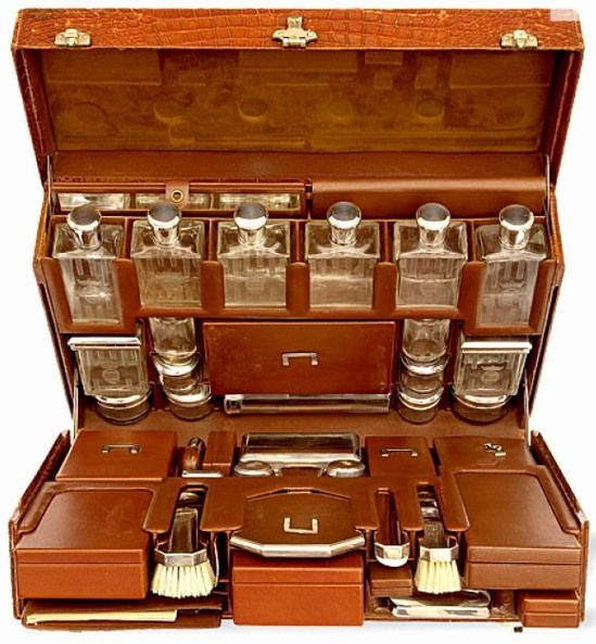 1930's Hermès suitcase. The interiors are crammed with pockets for all the essentials. Alcohol, Smokes, Playing Cards...