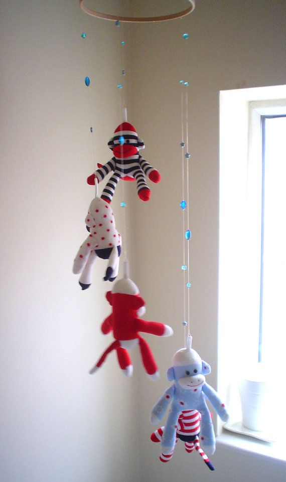 Mini sock monkey hanging mobile by Fiona Wilk. This would have been great in a sock monkey nursery!