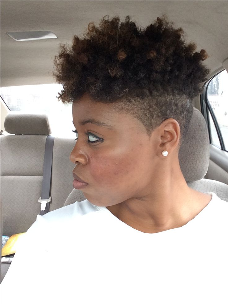 Shaved sides. Curly fro.