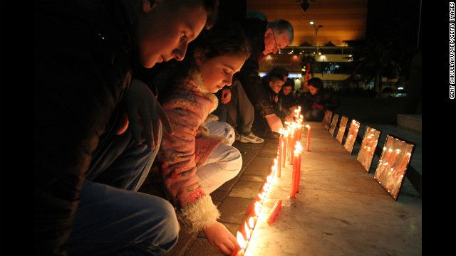 Children in Albania light candles to pay their respects to the victims of the Newtown, Connecticut, shooting.