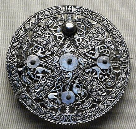 Anglo-Saxon brooch, ca.9th century, from the Pentney Hoard, in the Trewhiddle style. Trewhiddle refers to late Anglo-Saxon art that flourished during the ninth century and is named after the Trewhiddle Hoard from Cornwall, England. The style is characterized by its distinctive decoration with interlaced, contorted beasts and leafy scrolls; and in metalwork, by the preference for silver rather than bronze