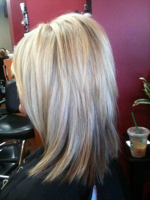 Long hair with angled layers kept shorter in back for volume and longer in front for a smooth frame-- eventually!! I like how they're short enough to give some oomph, but not so short that you get that reverse mullet/emo look.... No thank you! #hair #beauty
