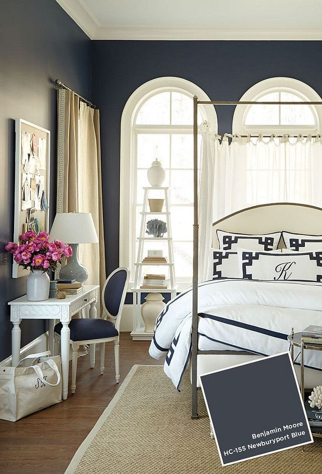 newburyport blue by benjamin moore makes a dramatic impact in this bedroom