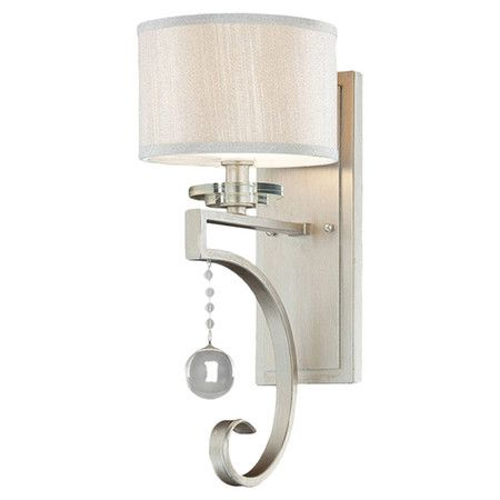 Featuring a silver sparkle finish and orb-shaped crystal drop, this elegant wall sconce is perfect for illuminating an intimate reading nook or adding hotel-...
