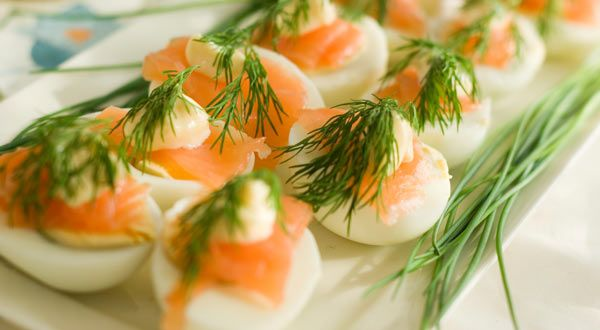 These hard-cooked eggs, dolled up with smoky New Brunswick salmon, will be gobbled up fast at any gathering.