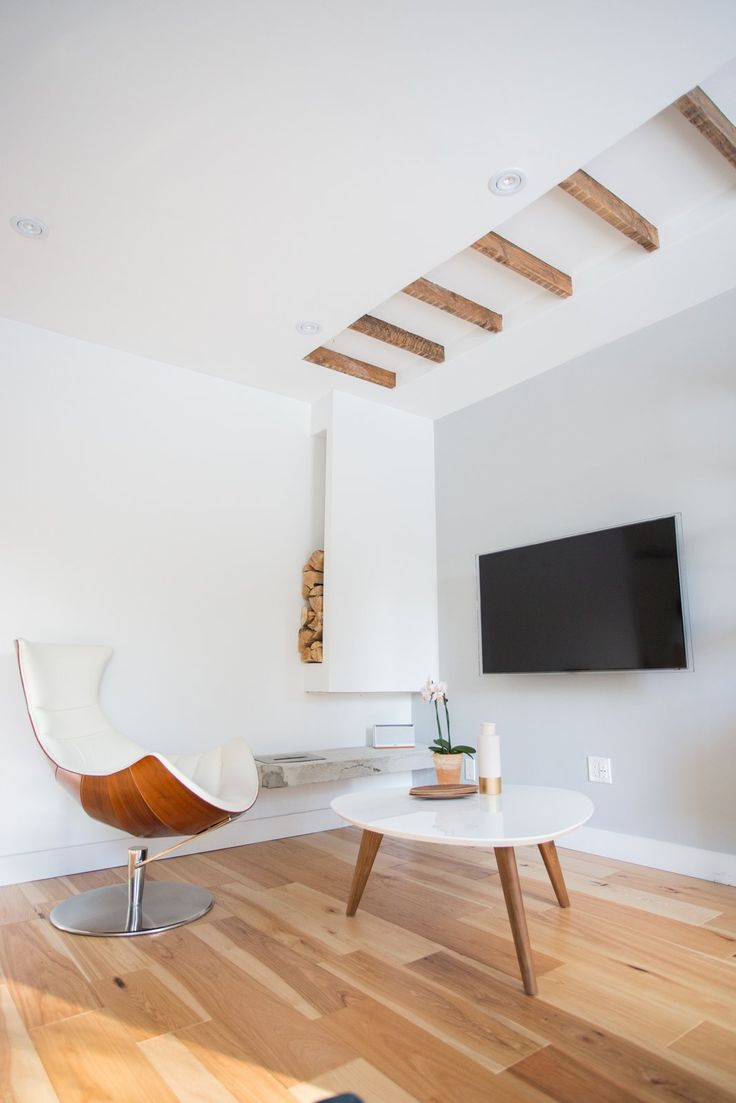In lieu of a fireplace, the pair opted for an exposed ethanol burner mounted on exposed concrete (the wood is just decor).