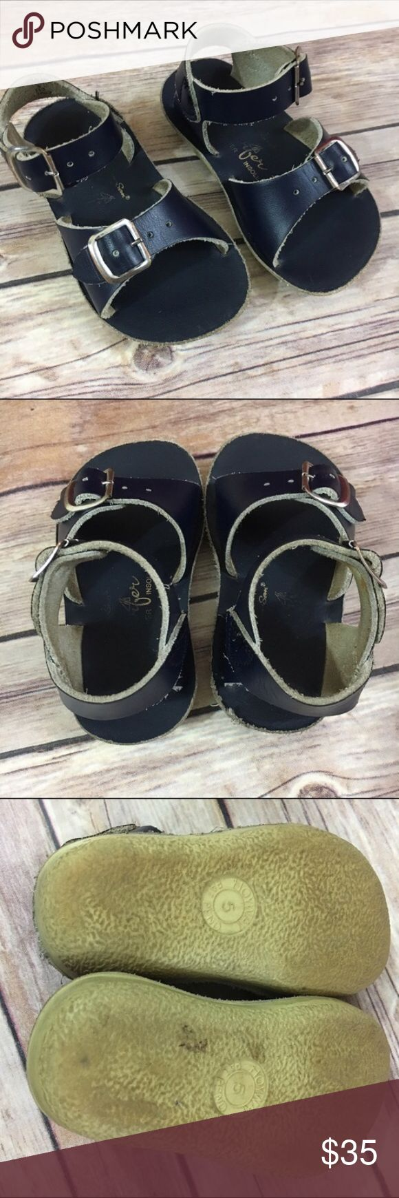 Sun-San Saltwater Surfer Sandals Navy Hoy 5 Sun-San Saltwater Surfer Sandals Navy Hoy 5  Very good used condition with a little more wear at the back of the right sandal as shown in picture.  These shoes last forever.  A true classic.  #sunsan #saltwater #salts #surfer #navy #sandals #boyssandals #coolkicks #summerkicks #blue #hoy Salt Water Sandals by Hoy Shoes Sandals & Flip Flops
