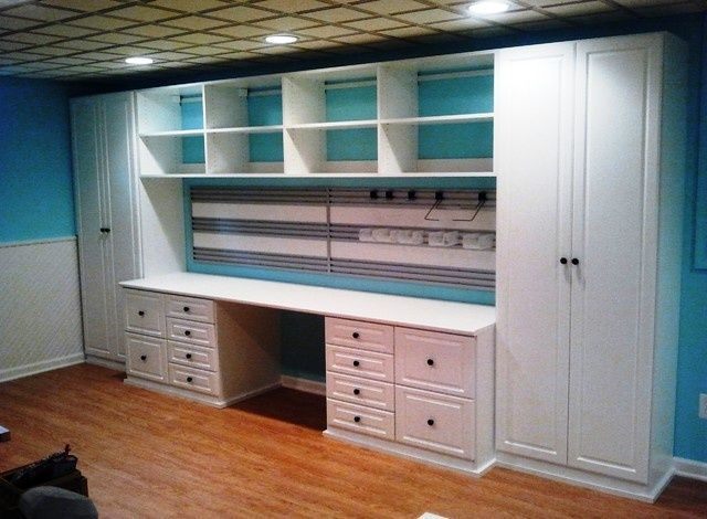 Love the idea of large cabinets for closed storage in between areas set aside for different crafting stations.