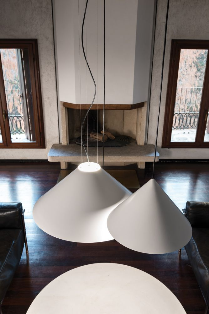 """Cone is a collection of pendant lamps with a basic shape expressing the downward lighting iconography. Available in three size, the smaller one can be in serial or clusters compositions, while the largest is also for direct and indirect lighting. """" #andcosta #andcostalamps #andcostalight #lamps #design #interiordesign #architecture #suspensionlamp #suspension #livingroom #lighting #ceilinglamps"""