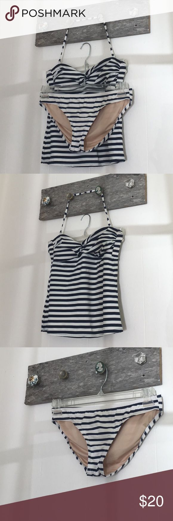 "J. Crew Nautical Tankini Practically brand new. Worn once. Size is small but runs a little loose on me. I usually wear a size 2 and my chest is a size 34"" J. Crew Swim One Pieces"