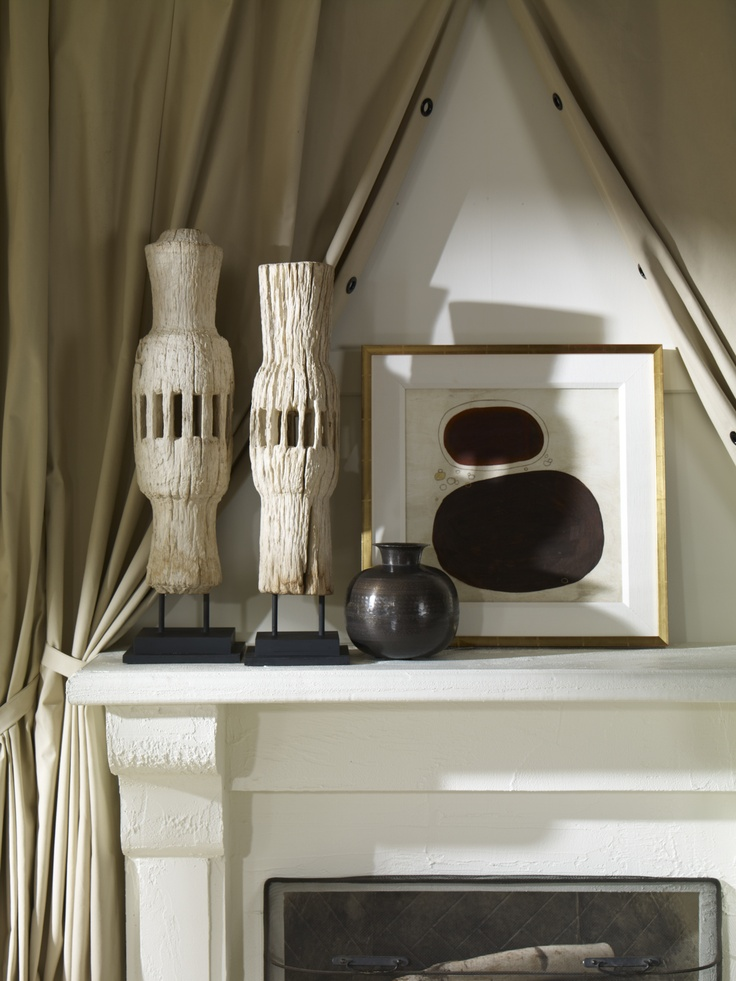 The golden rule of groupings: Repeat! Spheres, ivory hues, and tones of umber brown echo across this mantelscape.
