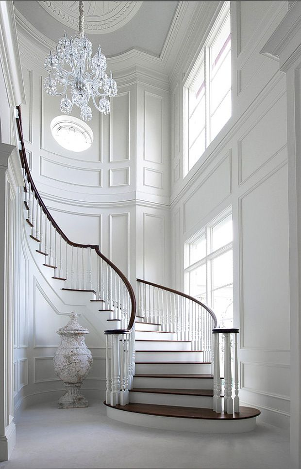 15 grand entrances that make a statement with moulding for Staircase ideas near entrance