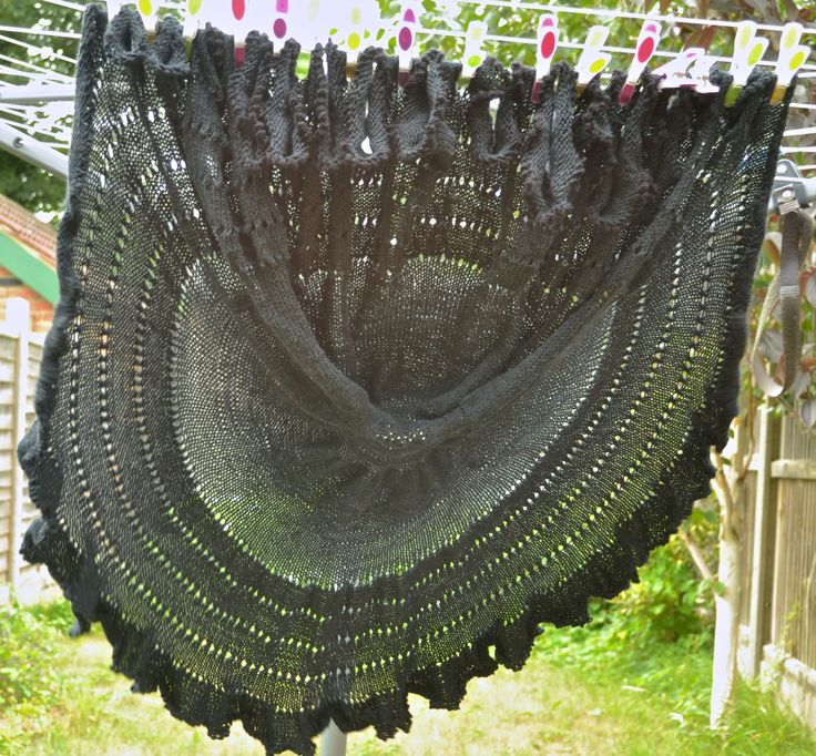 Picot Pi (off the needles, unblocked).  An update on my design is available here: http://makedoandmendnovice.blogspot.com/2015/07/going-full-circle-picot-pi-shawl-is-off.html