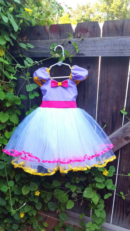 Daisy Duck dress, purple Daisy Duck costume , Daisy Duck Party Dress, purple dress, pink and purple dress, 1st Birthday party by loverdoversclothing on Etsy https://www.etsy.com/listing/155639656/daisy-duck-dress-purple-daisy-duck