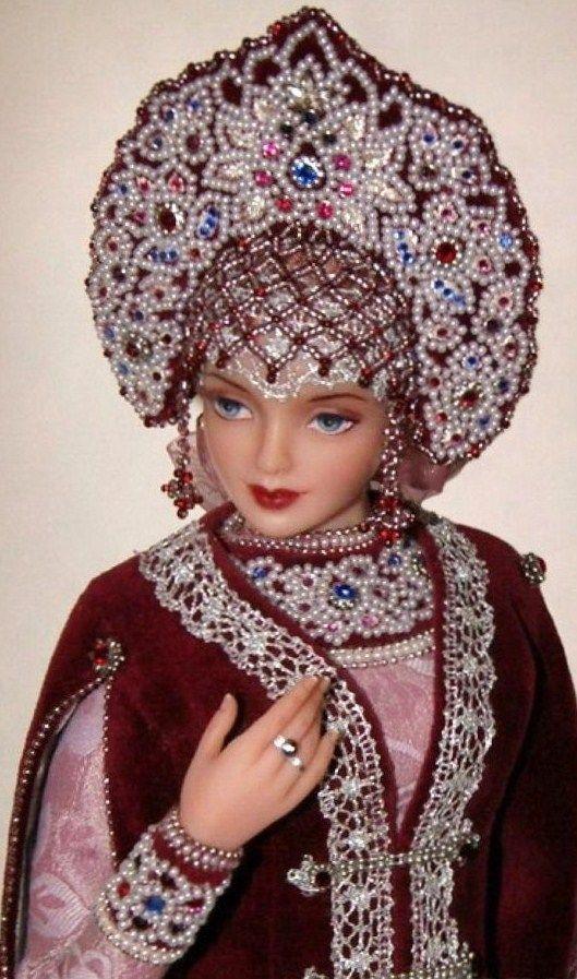 Doll wearing a kokoshnik. Russian medieval princess in traditional attire.