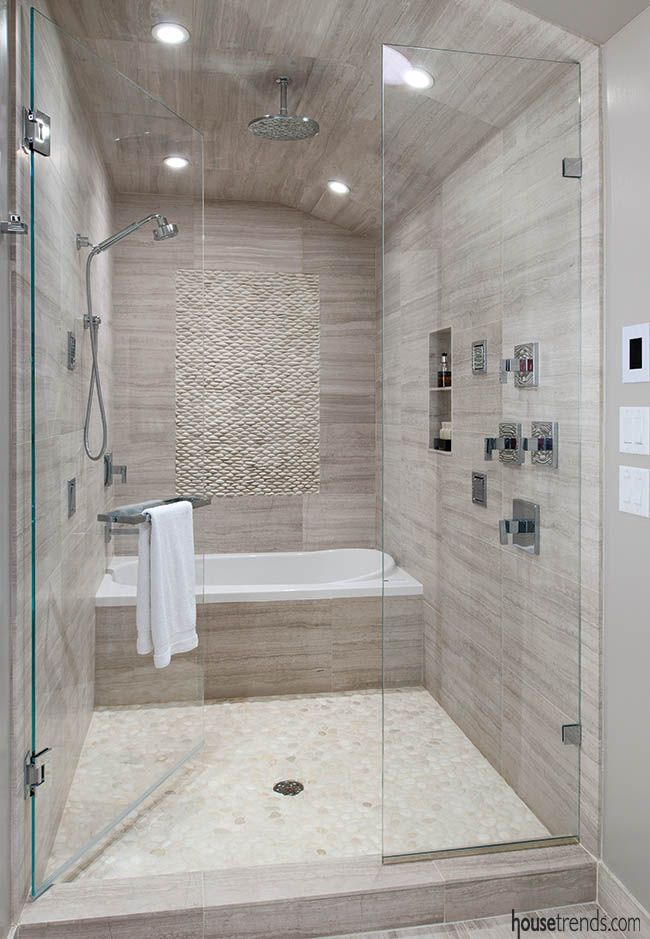 Bathroom design brings two spaces together..bathtub in the shower?
