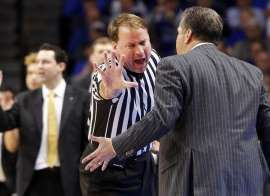 FILE - In this Feb. 28, 2017, file photo, Kentucky head coach John Calipari, right, address official John Higgins after being assessed a technical foul during the second half of an NCAA college basketball game against Vanderbilt, in Lexington, Ky. Referee John Higgins of Omaha has contacted law enforcement to report hes received death threats after Kentuckys loss to North Carolina in the NCAA South Regional final.A person with knowledge of the situation told The Associated Press that Higgins…