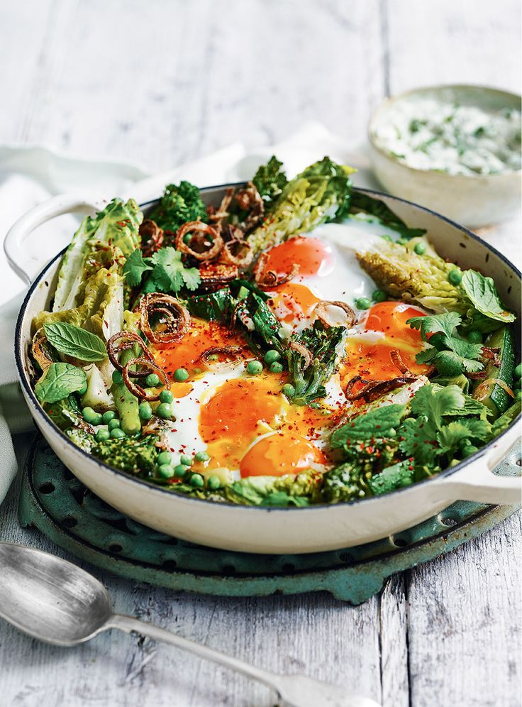 Shake up the classic tomato shakshuka recipe with layers of fresh greens, finished off with fried shallots. It makes for a great vegetarian centre piece.