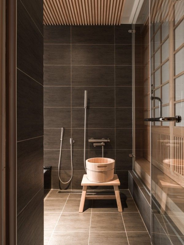 interior design chrome hand shower brown ceramic tile wall glass door japanese style bathroom brown ceramic tile floor and wooden ceiling cozy modern