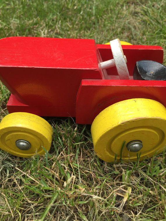 Real nice wooden tractor. Bright coloured and a perfect vintage toy for a modern child. Because second hand toys, save the planet :)