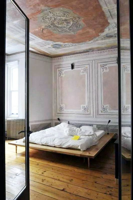 rustic pink paint in minimalist vintage bedroom. / sfgirlbybay