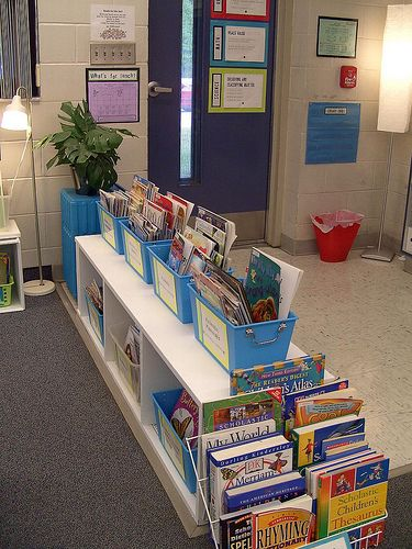 Classroom library organization  use bins on top to store student journals or notebooks