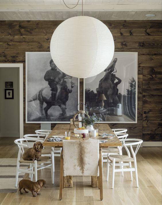 Wishbone chairs, soft throws, an oversized pendant – there is nothing we don't love about this cosy Scandinavian-style dining room. Image: Livingetc