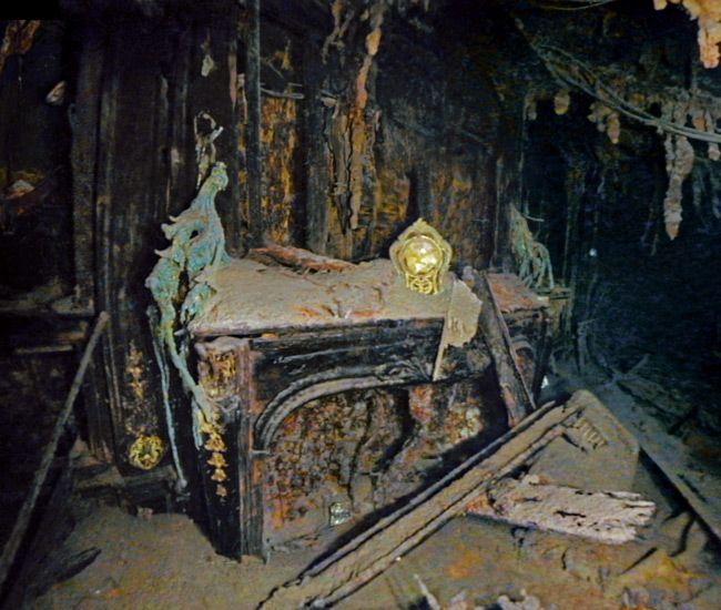 The Titanic ruins - a gilded clock rests intact on an electric fireplace in the elegant Straus suite. Description from pinterest.com. I searched for this on bing.com/images