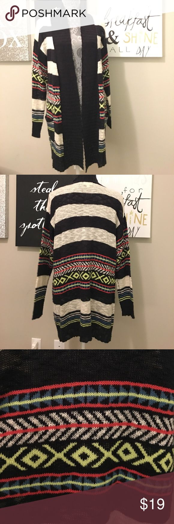 """Stripe and Tribal Print Long Cardigan Super cute and cozy stripe and tribal print long cardigan. The tribal print colors are hot pink, real, and a bright yellow-green. The stripes are black and ivory. This cardigan is in excellent condition and has only been worn once. I paired it with a black tank top, jeans, and some over the knee boots! It's a necessity in every woman's closet! The brand """"eyeshadow"""" is from Charlotte Russe. Eyeshadow Sweaters Cardigans"""