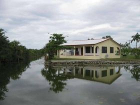 House surronded by water, Corozal, Belize – Best Places In The World To Retire – The cost to rent a two-bedroom, and possibly two-bathroom Belizean home in Corozal is about BZ $800 or US $400 a month.   The price can change depending on the location. It could go up to BZ $1,500 or US $750 if the same house is located on the seaside.