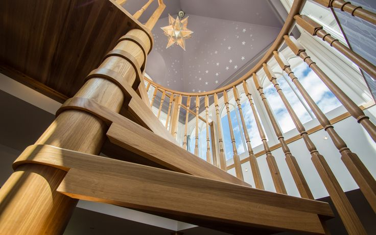 An up close and personal shot of a timber spiral staircase.