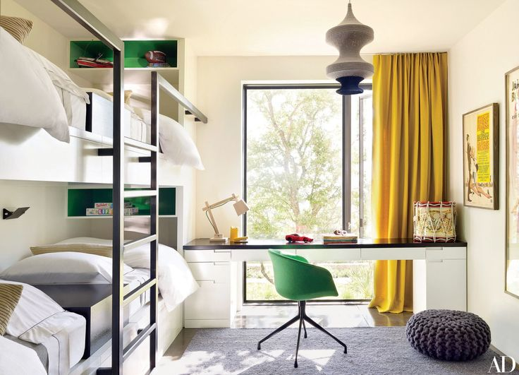 #bunkbeds #guestbedroom #childrensbedroom #bedroom | The children's bunk room is accented by a Claremont-fabric curtain and a chair from Karkula.