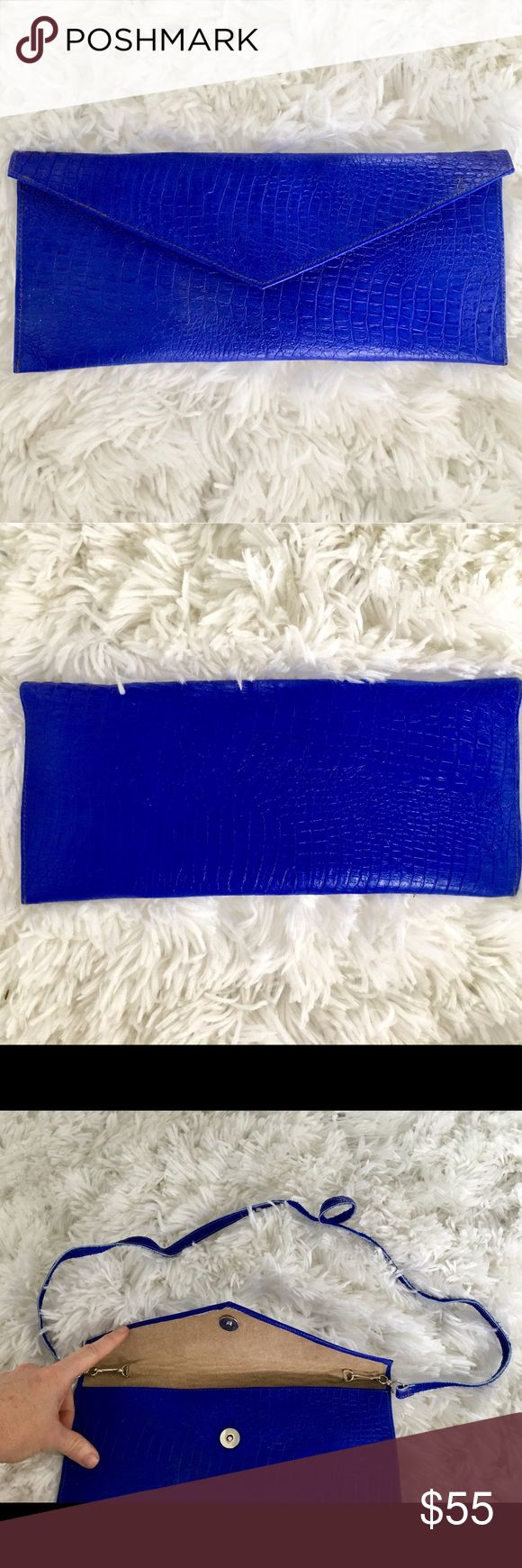 Electric blue clutch. Faux animal skin clutch with snap button closure.  Optional shoulder strap. Bags Clutches & Wristlets