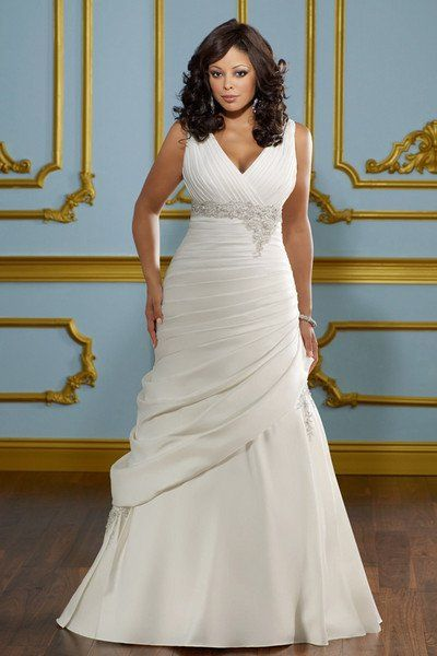 A-line gowns are universally flattering, with clean lines flaring out at the hips to elongate the torso. You'll find many variations of the A-line silhouette, including princess, slim A-line and drop-waist dresses. This is a great choice for brides who want a streamlined effect overall.Mori Lee, Style 3114 (available in sizes 16-32)