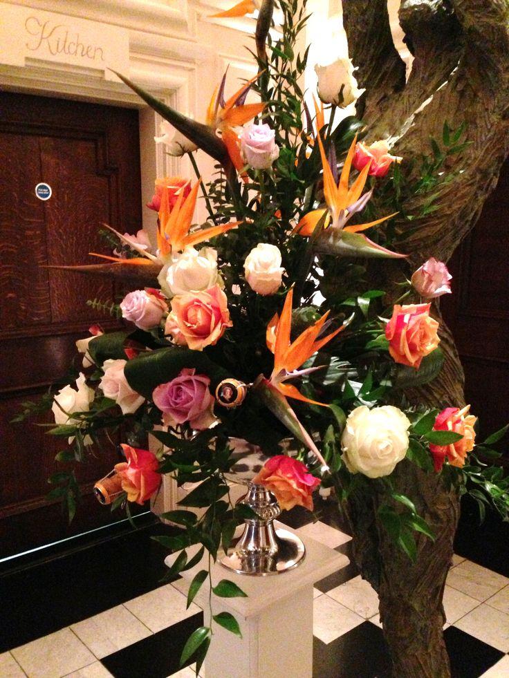 Bright pedestal wedding flowers