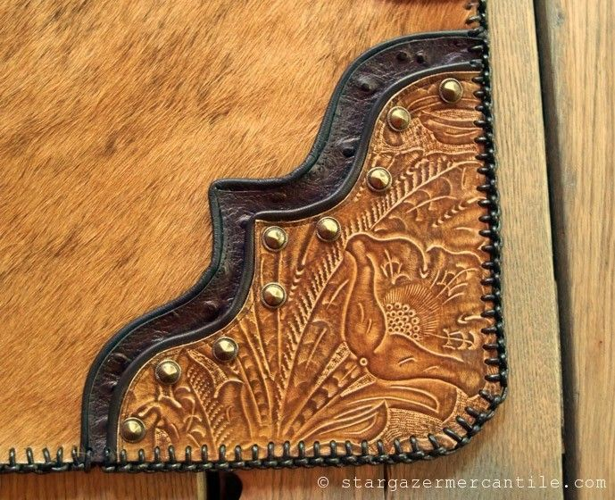 Our Western style #leather place mats (with matching napkin ring!) double as table toppers!  Caramel and black, embossed ostrich, hair-on cowhide, solid brass conchos and precision edge lacing add WOW to your home!