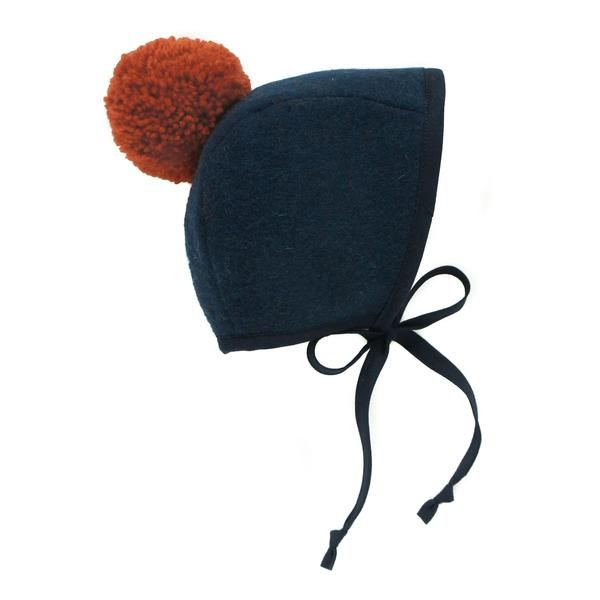 Pom-pom bonnets! Too cute.